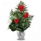 Tres rosas rojas